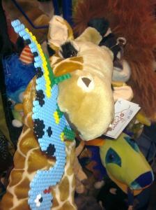 Giraffe eating a dinosaur